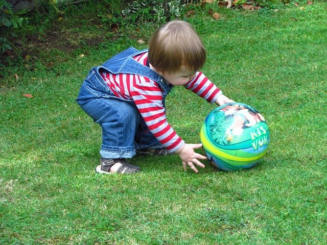 Toddler Playing With Ball