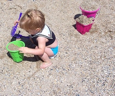 Toddler Playing With Sand